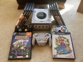 GameCube console, three controllers and ten games