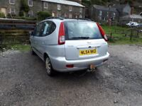 Chevrolet Tacuma with 11 months MOT,old dog but reliable.