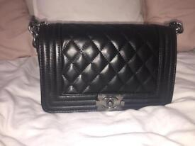 Women's black Quilted leather boy bag with cross body chain strap in grey hardware