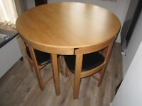 Space saver dining table and four chairs