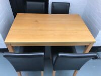 Solid wood dining table with 4 leather chairs