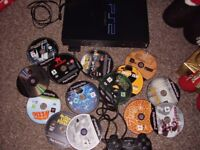 PLAYSTATION 2 BLACK WITH LOADS OF GAMES