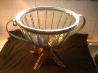 large glass bowl on metal stand