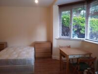 Large double room 50 meters away from tube and shops