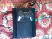 PS3 Slim console with games.
