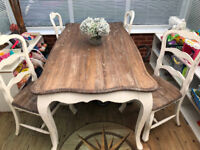 Large Shabby Sheik dining table and 4 chairs. Immaculate condition. First £100 ono will secure it