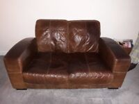 2 piece brown leather sofa and footstool