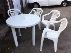Plastic table and 4 chairs.