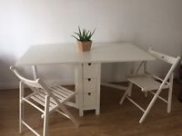 Foldable dining table + 5 chairs