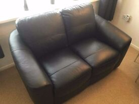 Sofa black leather 2 seater, immaculate condition.