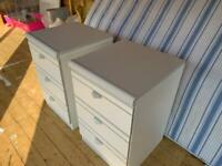 Two grey and white bedside chest of drawers