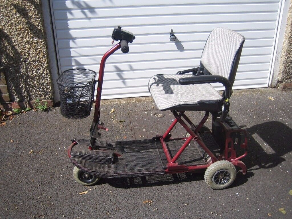 A Car boot portable Mobility Scooter. Good Condition with battery charger and security lock