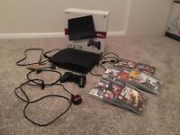 PlayStation 3, with selection of games (like new condition)