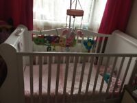 Baby's white sleigh cot bed