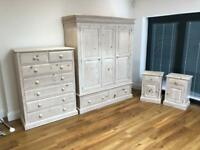 Wardrobe, chest of drawers and two bedside cabinets.