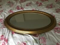 Large vintage gold oval mirror