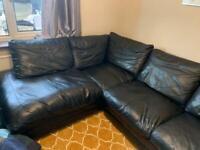 Black leather corner sofa bed