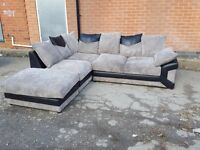 Very nice black and grey cord corner sofa and foot stool.or larger corner.1 month old. can deliver