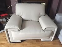 Set of barely used comfortable beige leather armchair and recliner in great condition - £100
