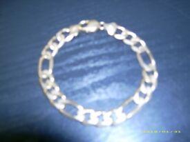 heavy 9 carat solid gold figaro bracelet