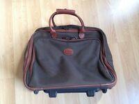 Longchamp Wheeled Suitcase. Good condition.
