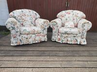 pair of matching armchairs, it has a couple of dirt marks on it, the covers are machine washable.