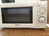 Microwave - never used, Sanyo EM-S105AW in white. Only £15.