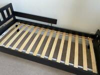 Kids black IKEA bed with guard rail