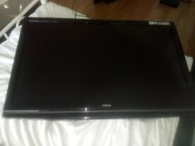 Hitachi 42 Inch TV working in good condition, comes with stand and wall brackets