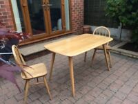 Ercol solid wood dining table