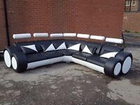 Cute large black and white leather corner sofa.Superb modern design. 1 month old. can deliver
