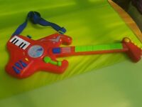 Children Electric Guitar red ((sounds and lights))
