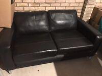 John Lewis black two seater leather sofa