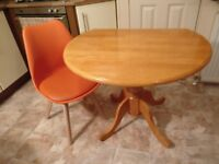 Drop leaf dining table with 2 orange chairs