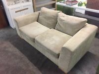 Beige two seat sofa