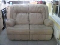 An electrically operated 2 seater beige leather recliner sofa and 2 manual recliner leather chairs.