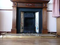 Fireplace surround, black iron inner, tile display, grate, marble hearth, brass fender