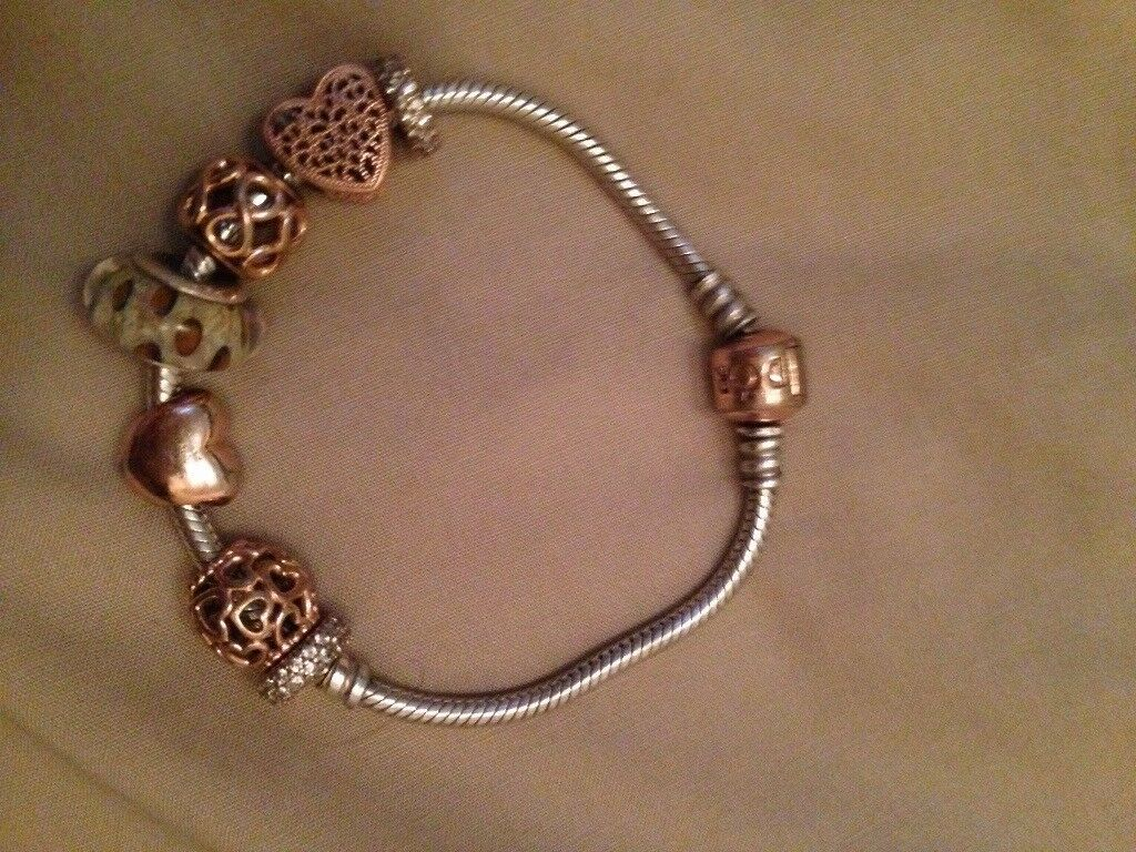 Genuine Pandora Bracelet With Rose Gold Clasp And 7 Charms In