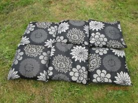 BLACK CUSHIONS WITH GREY AND SILVER FLORAL PATTERN ON THEM X 6
