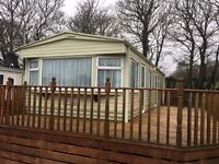Cosalt Rimini 2 Bedroom Super Double Glazed Sited With Full Decking on Whitewell Holiday Park Tenby