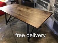 As new dinning Table on a metal base