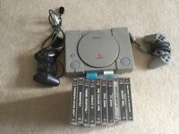 PlayStation 1 with all the cables and various games
