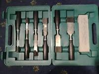 Chisel set in case with sharpening stone in case.