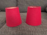 Twin red lampshades