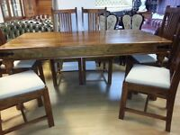 brand new condition solid wood dining table and 6 chairs. Very strange and heavy table and chairs.