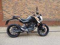 KTM Duke 125 2015 8,947 miles, white comes with warranty