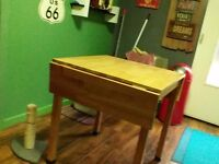 Oak table and 4 red faux leather chairs