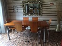 Beautiful modern dining table and chairs