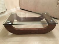 Boat shapes glass coffee table