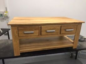 Brand new ex display Solid oak coffee table. Can deliver free
